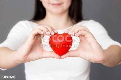 1035479448 istock photo Holding Heart 488618084