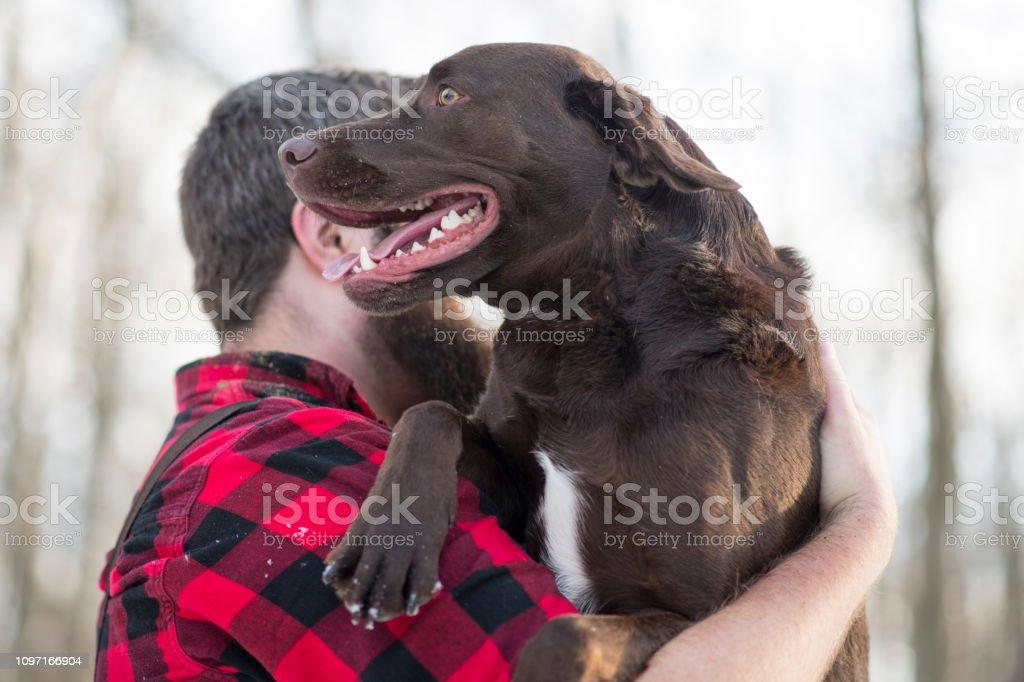 Holding his Dog stock photo