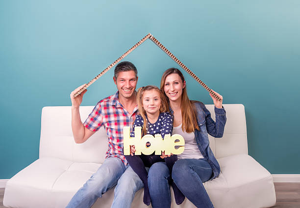 holding home letters for real estate stock photo