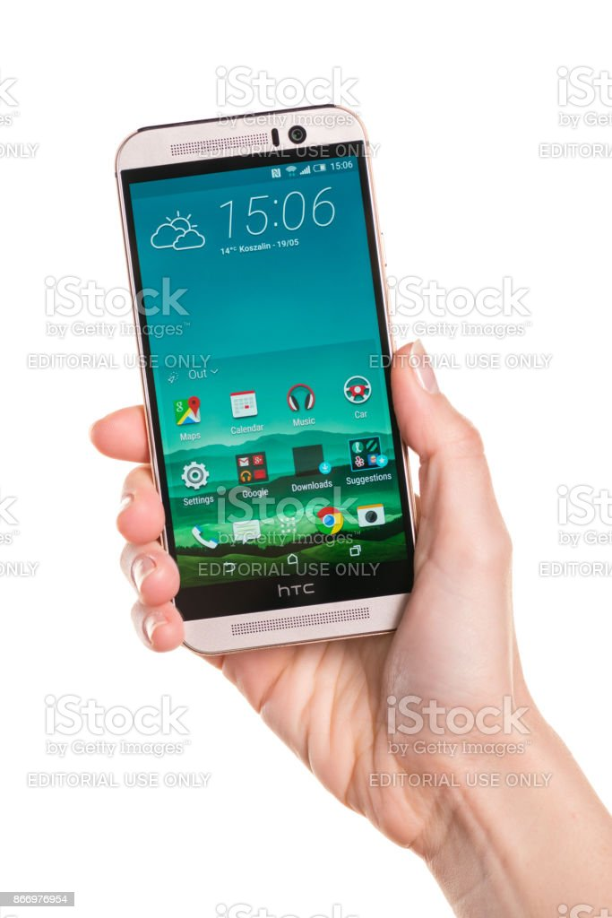 Holding HTC One M9 in a right hand stock photo