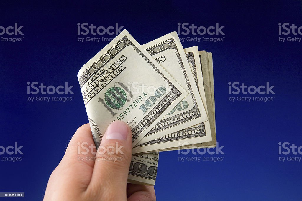 Holding Hundred Dollar Bills royalty-free stock photo