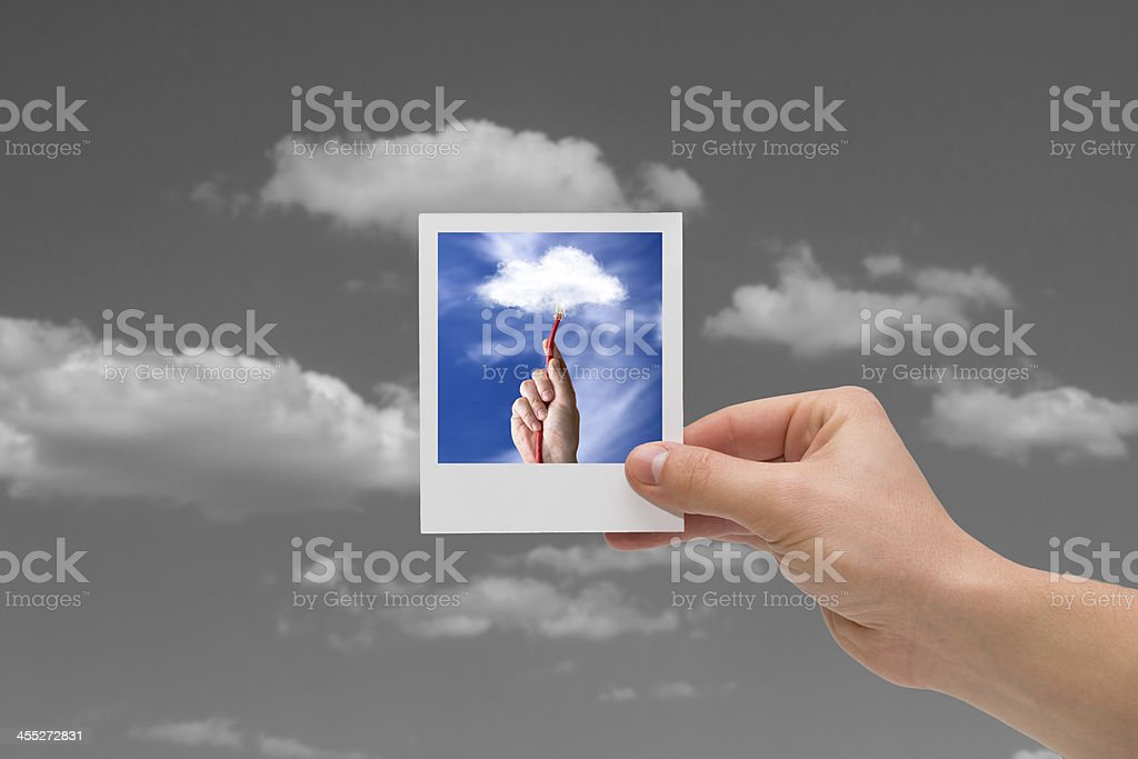 Holding Instant photo. Cloud computing concepts. stock photo