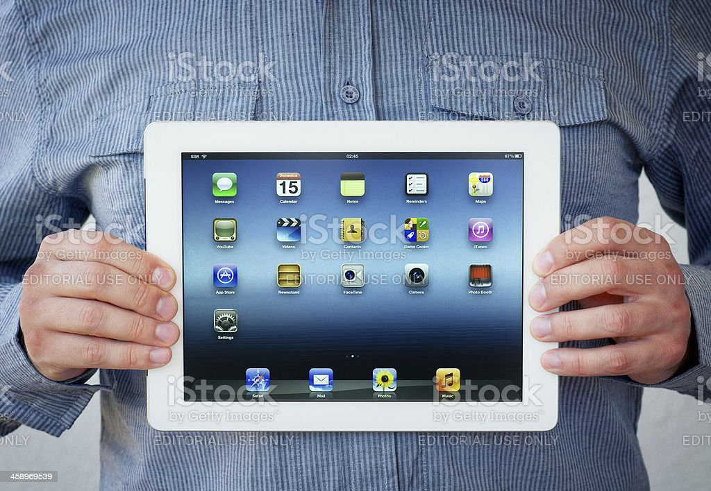 Holding iPad. Clipping path for the screen stock photo