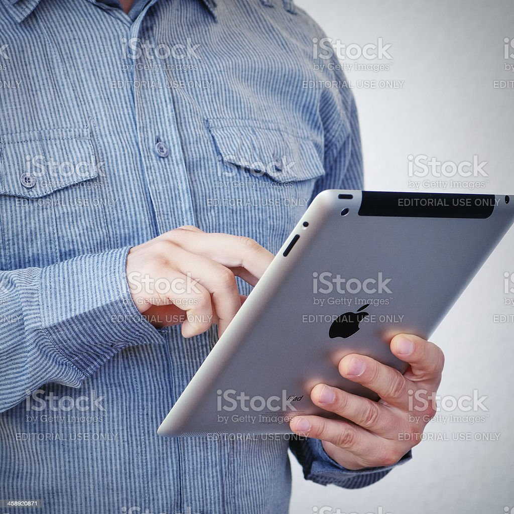 Holding iPad royalty-free stock photo