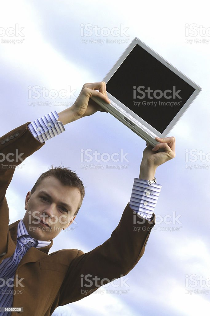 Holding laptop royalty-free stock photo
