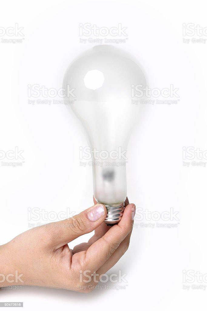 Holding Lightbulb royalty-free stock photo