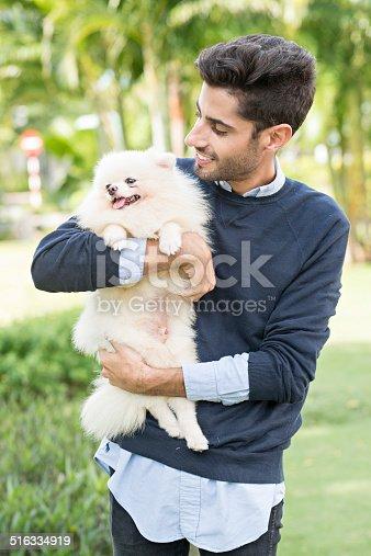 istock Holding little dog 516334919