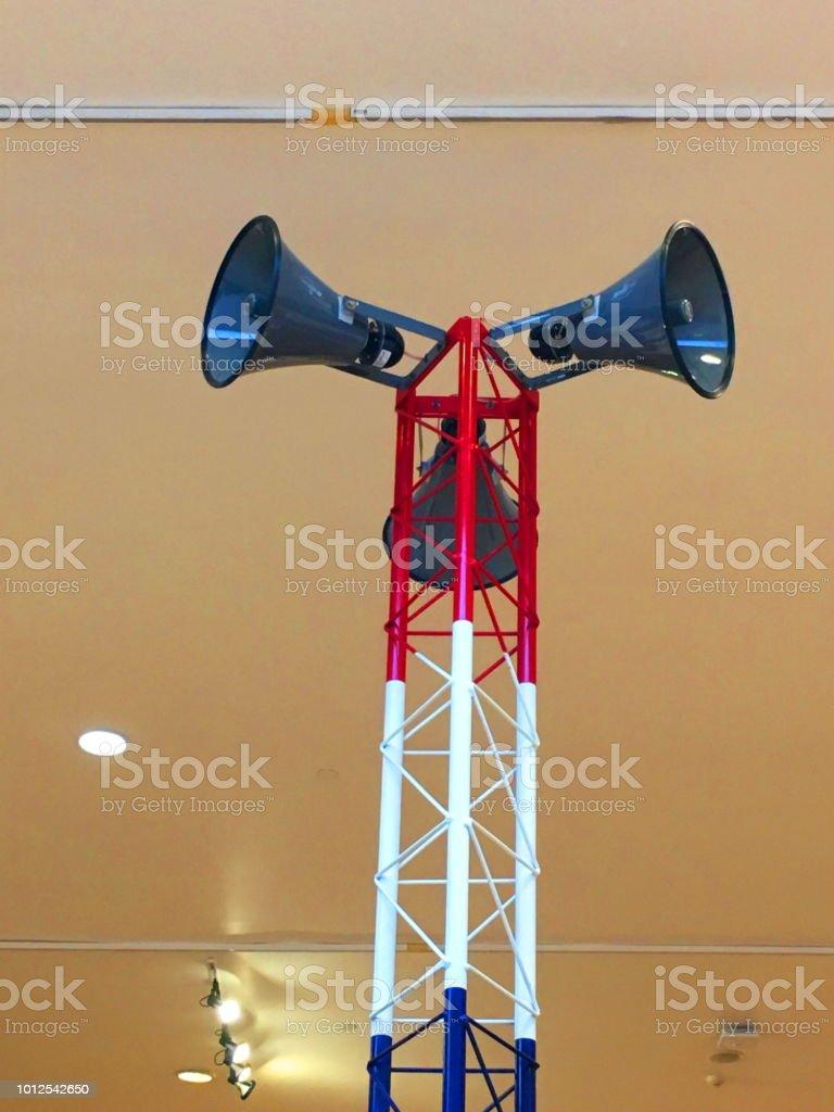 Holding megaphone.Horn speaker for public relations sign symbol