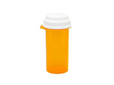istock holding messy colored Copper wire on isolated white backgroundempty orange Medicine or pill bottle on isolated white background 1135131757