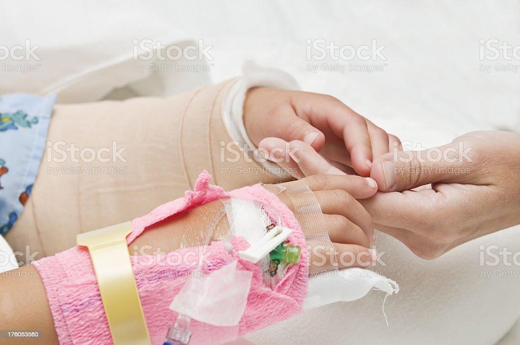 Holding Mom's Hand royalty-free stock photo