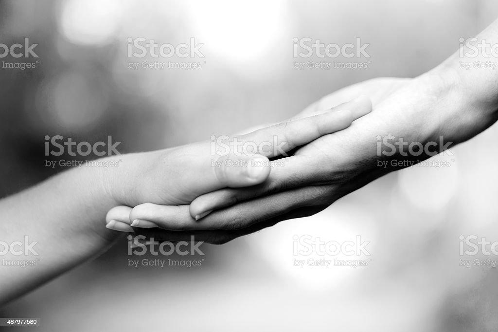 Holding Monochrome Hands stock photo