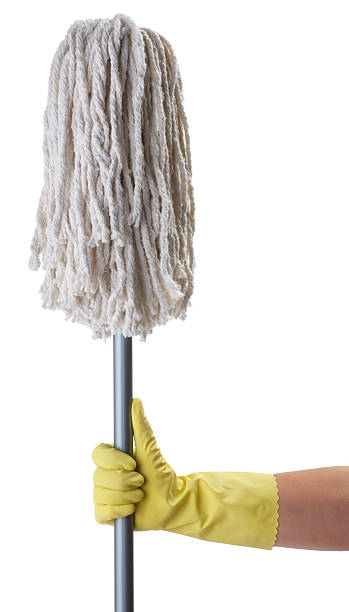 Holding Mop A woman in a latex glove holding a mop.For more chore related images click on link below: mop stock pictures, royalty-free photos & images