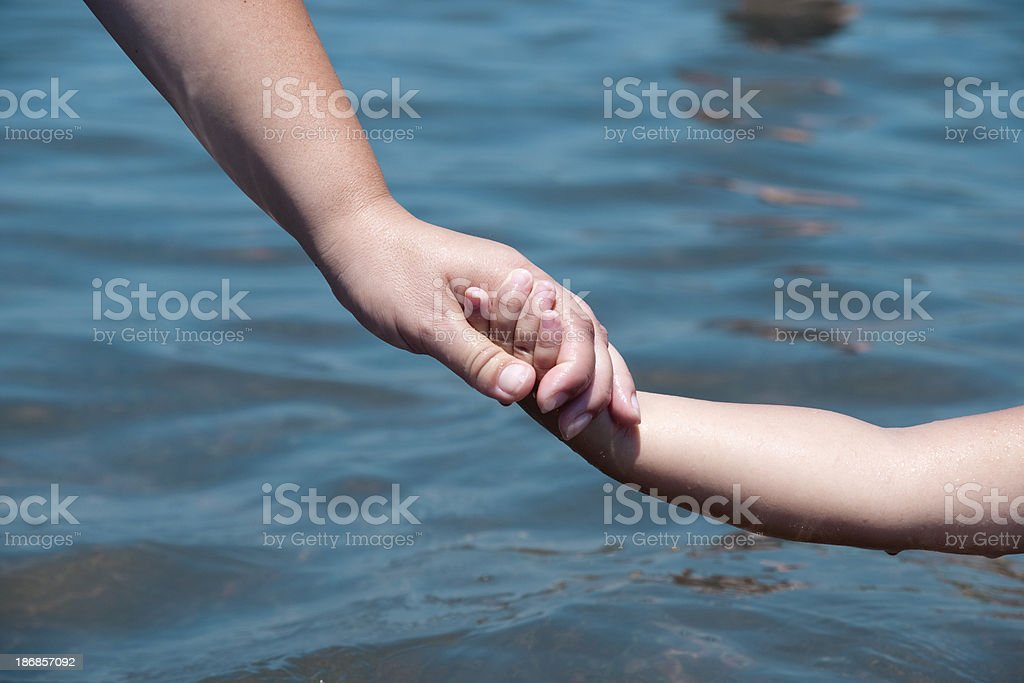 Holding Mother's hand royalty-free stock photo