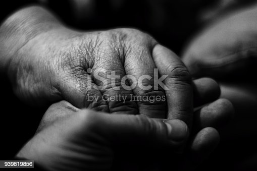 499062115istockphoto Holding my grand mother's hand 939819856