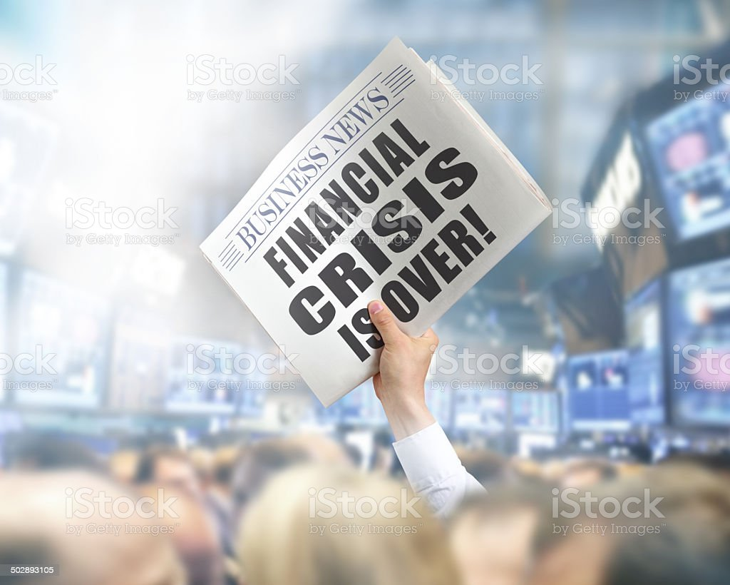 Holding Newspaper Financial Crisis Over stock photo