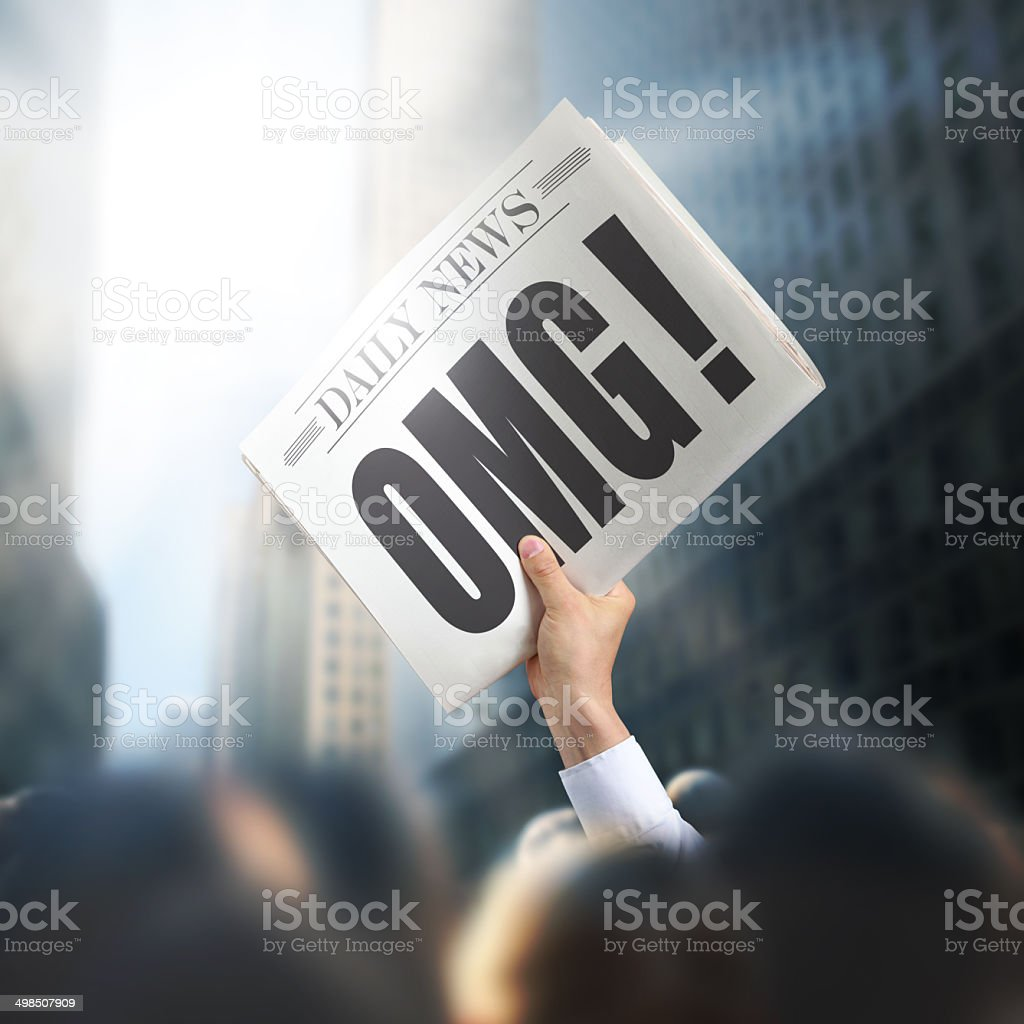 Holding Newspaper with OMG stock photo