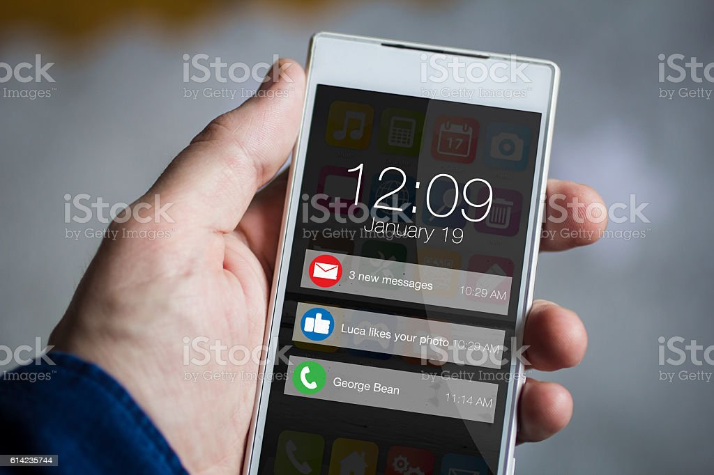 holding notifications smartphone stock photo