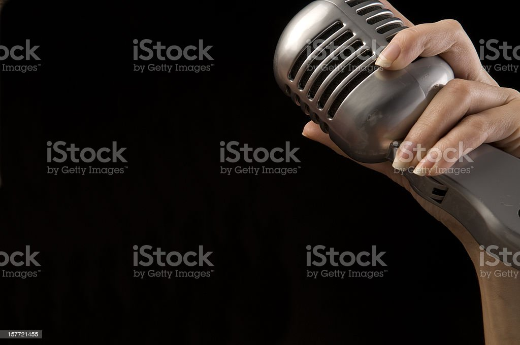 holding old style microphone royalty-free stock photo