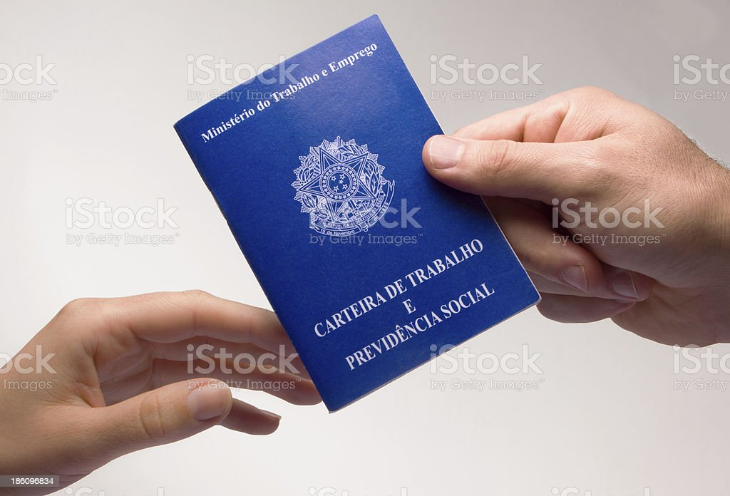 Holding on carefully to a blue Brazilian document royalty-free stock photo