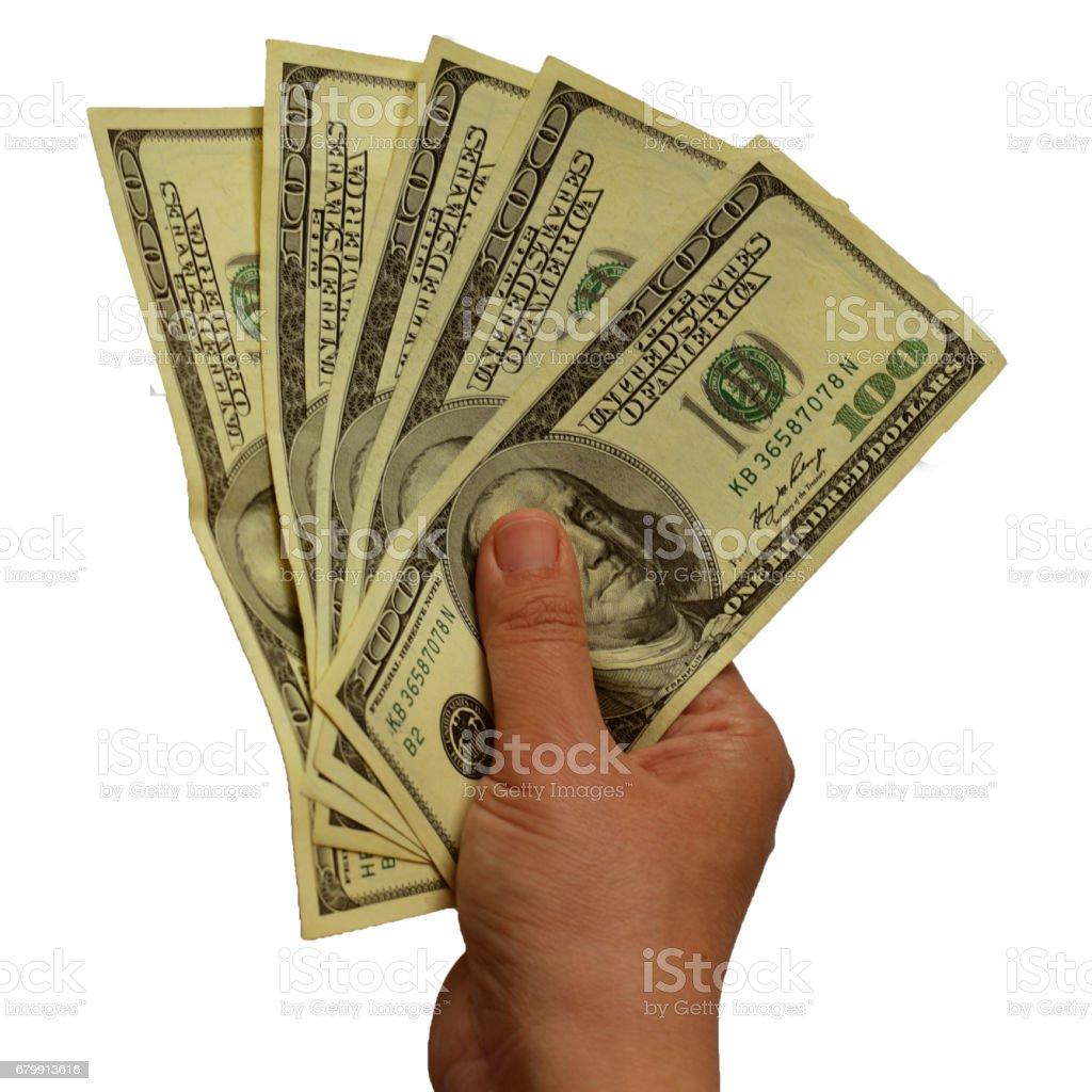 Holding one hundred dollar bills stock photo
