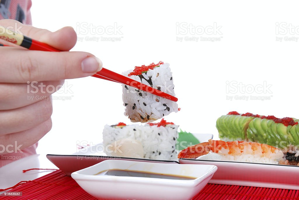 Holding one roll with chopsticks royalty-free stock photo