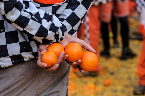 Holding oranges