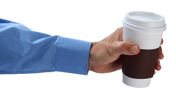 Holding Out a Cup of Coffee stock photo