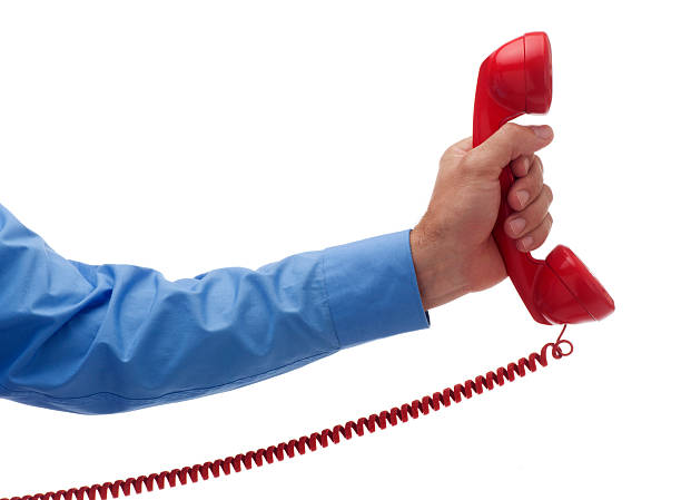 Holding Out a Red Phone on White stock photo