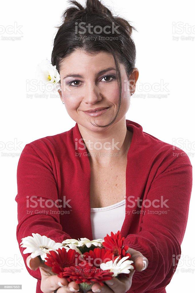 Hält Sie Blumen Lizenzfreies stock-foto