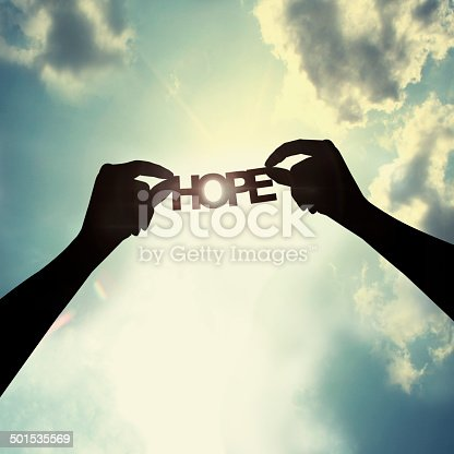 istock Holding paper cut of hope 501535569