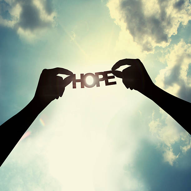 Holding paper cut of hope Show the paper cut word in the sky single word stock pictures, royalty-free photos & images
