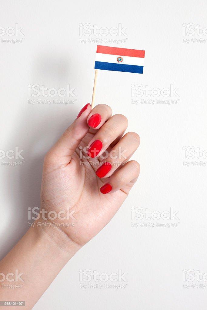 Sosteniendo bandera paraguaya - foto de stock