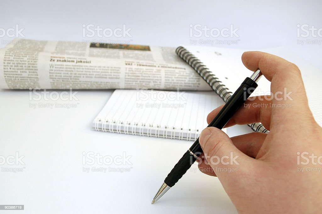 holding pen - newspaper and notebook in background #3 royalty-free stock photo