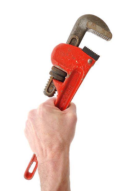 Holding Pipe Wrench in Hand  adjustable wrench stock pictures, royalty-free photos & images