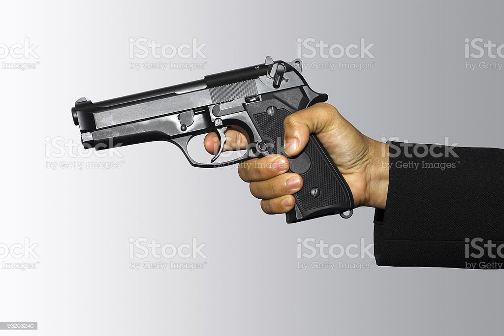 Holding pistol royalty-free stock photo