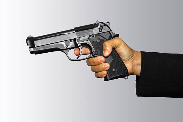 Holding pistol stock photo