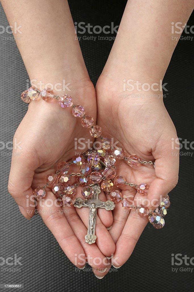 Holding rosary beads stock photo