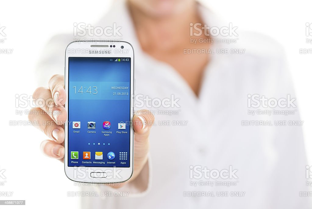 Holding Samsung Galaxy S4 royalty-free stock photo