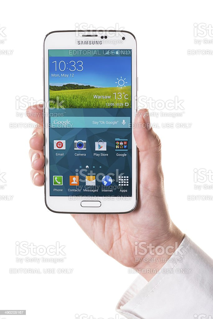 Holding Samsung Galaxy S5 royalty-free stock photo