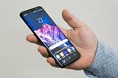 Holding Samsung Galaxy S8