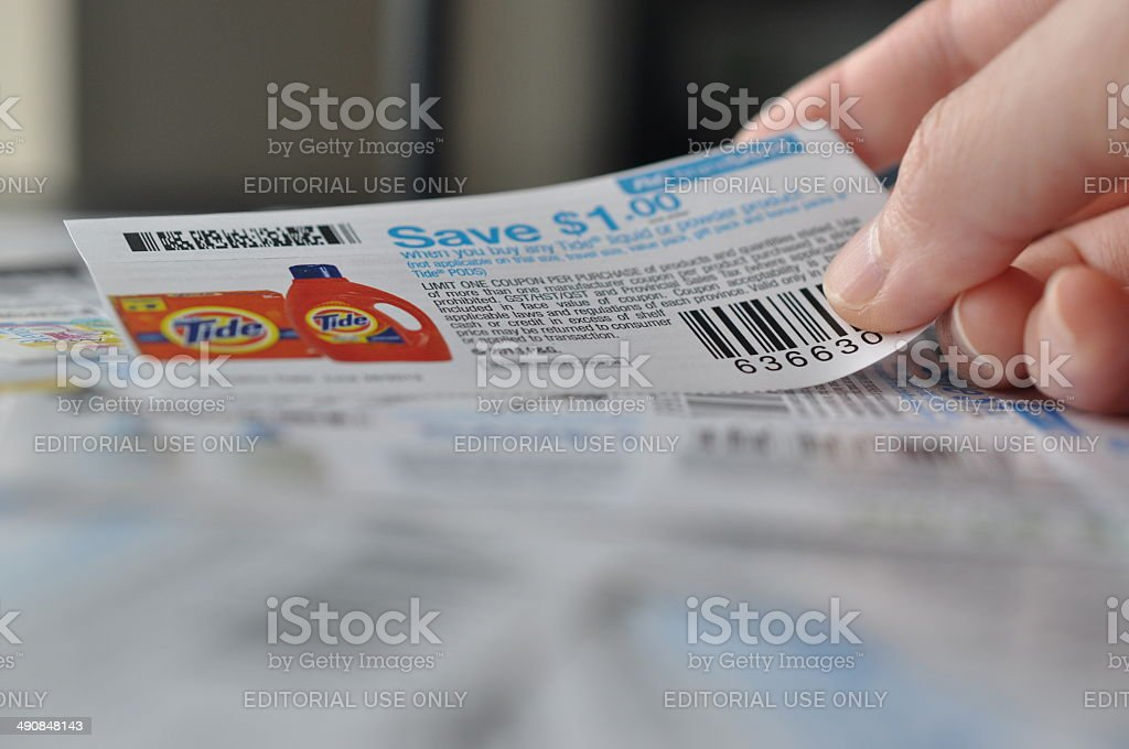 Holding save one dollar coupon stock photo
