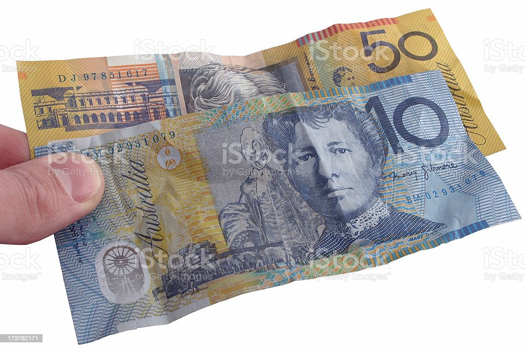 Holding Scrunched Australian $60 notes royalty-free stock photo