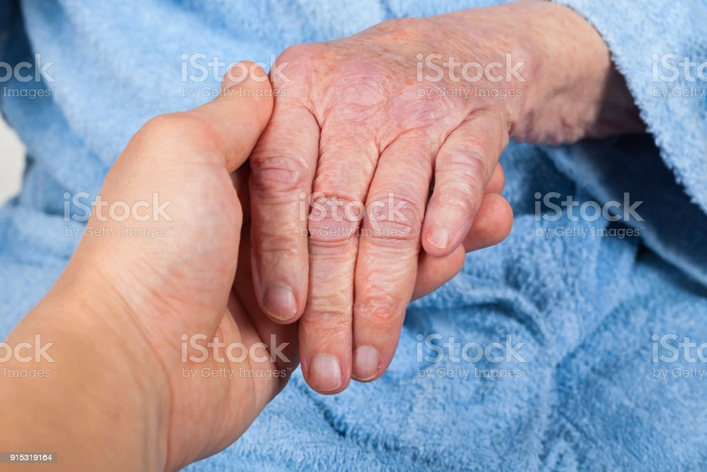 Holding senior woman's hand stock photo