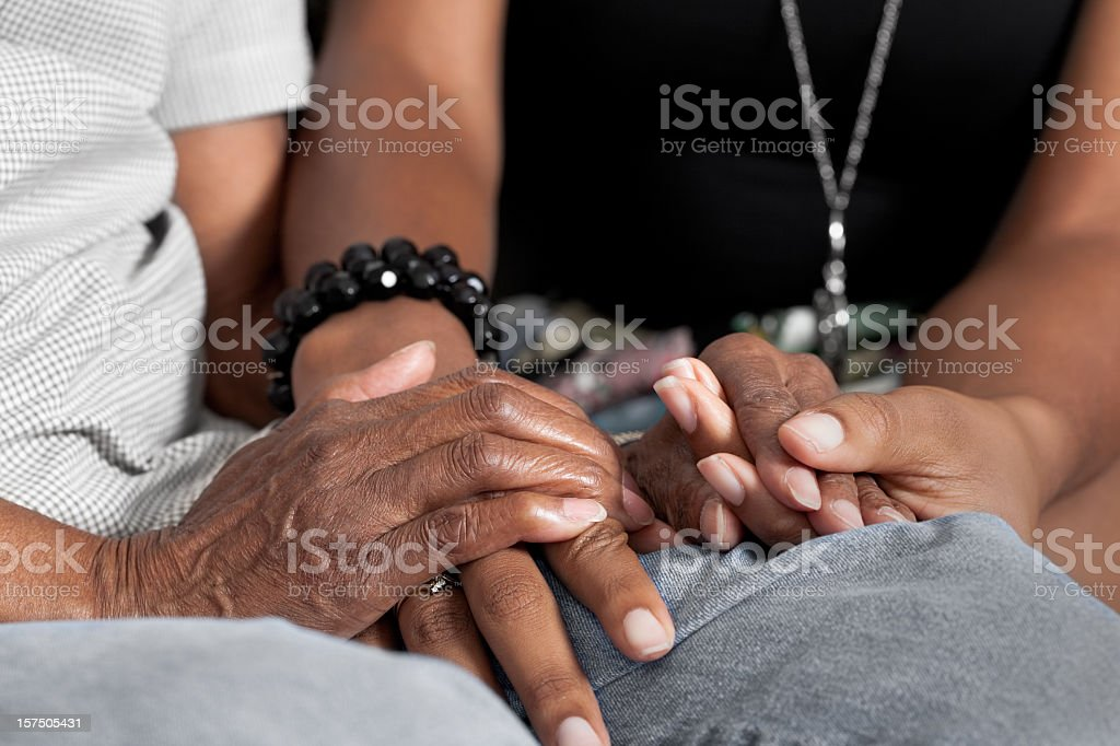 Holding seniors hands stock photo