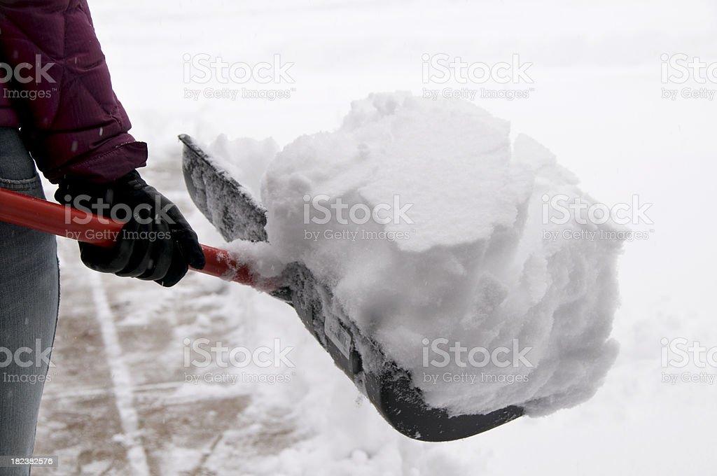 Holding Snow Shovel stock photo