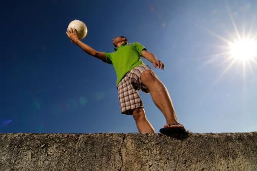 Holding soccer ball