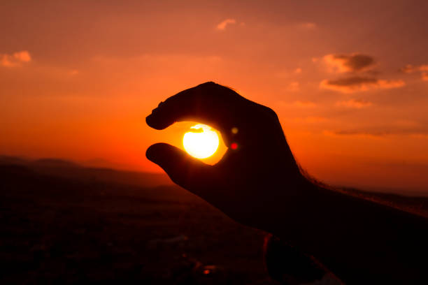 Holding sun with Fingers . Power of perspektive and silhouette. Sunset, Turkey - Middle East, Adult, Adults Only, Adventure, Cloud - Sky perspektive stock pictures, royalty-free photos & images