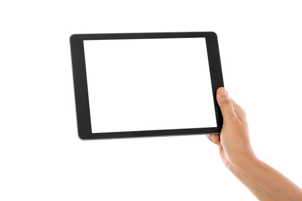holding tablet computer against white background - tenue photos et images de collection