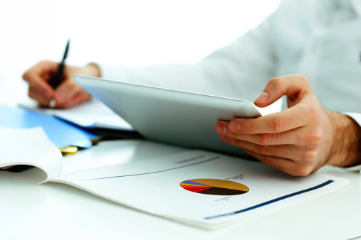 Holding Tablet Computer Stock Photo - Download Image Now