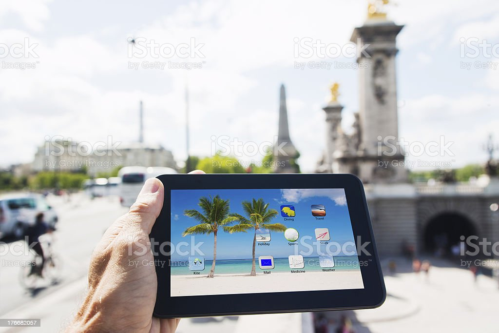 Holding tablet PC in Paris royalty-free stock photo